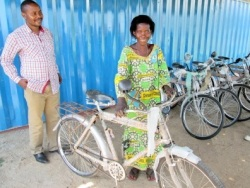 Luc with bicycle recipient
