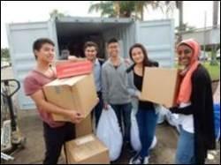 Rotaract members help pack on April 11 2015