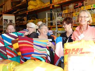 Many volunteers came along to help sort everything from Wrap with Love handmade blankets to toys and medical equipment. Hard work but fun!