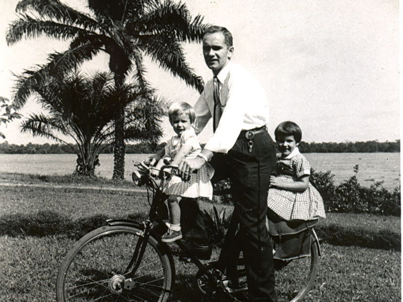 Ben with daughters Lucy (left) and Anne (right) take a ride along the Congo River.
