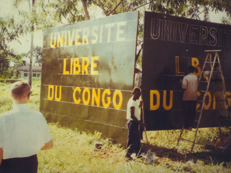 Ben (left) supervises the construction of the ULC's entry sign in Stanleyville (now called Kisangani). The university has grown from three students to more than 8,500. It is now based in Congo's capital, Kinshasa.